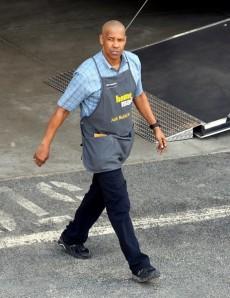 Robert McCall in uniform at Home Mart